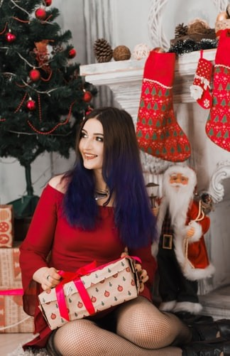 woman holding holiday box
