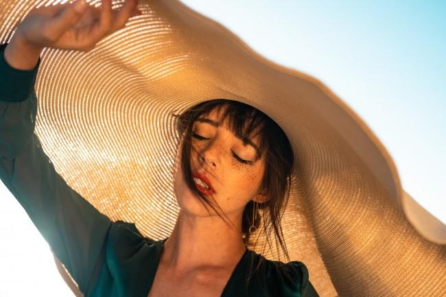 https://www.pexels.com/photo/woman-under-brown-hat-2906663/